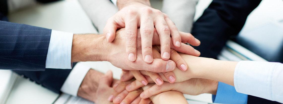 team-building-hands-1140x420.jpg